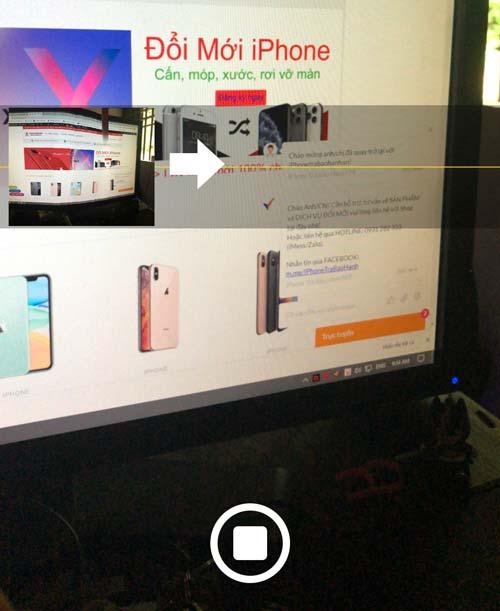Nhấn vào chụp ảnh và xoay màn hình iPhone theo hướng mũi tên